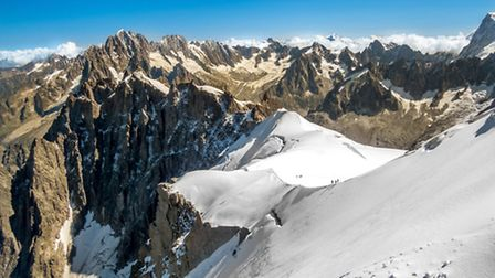 A view towards a glacier from the top of the Aiguille du Midi in the Mont Blanc massif