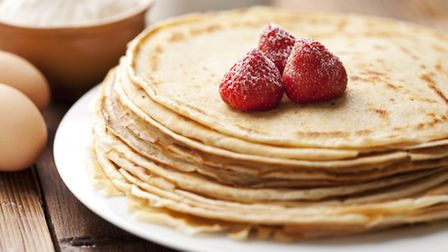 A stack of crêpes topped off with raspberries © Fotolia
