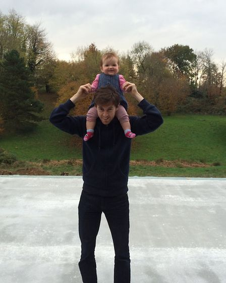 Tom and daughter Molly stand on the new concrete slab