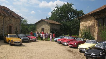 A farmhouse and barns converted into classic car storage!