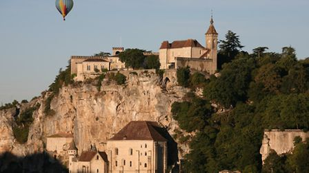 A hot air balloon floats over the Plus Beau Village of Rocamadour in the Dordogne Valley © Lot Touri