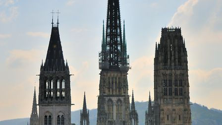 The Notre-Dame Cathedral towers above the quaint old buildings in the centre of Rouen
