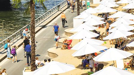 Visitors relax and unwind on the makeshift beaches along the Seine