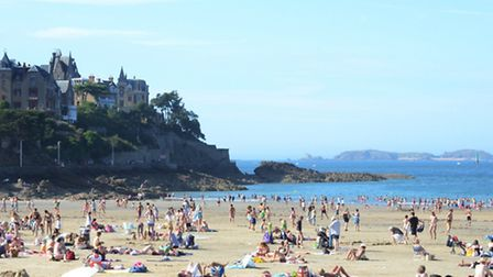 Visitors relax on the sandy Plage de l'Écluse in the centre of Dinard