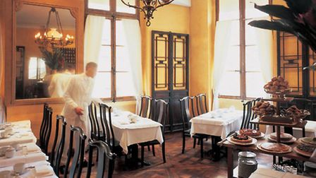 The upstairs tearoom in Mariage Frères has a certain old-world charm