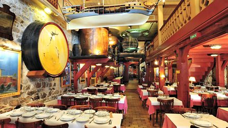The maritime-themed main dining room of Le Bar André