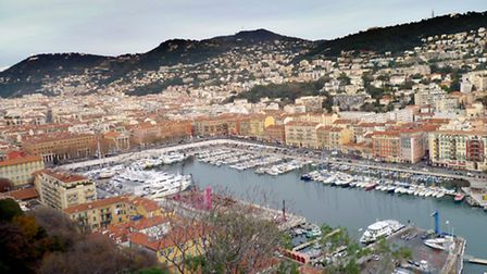 The striking old port of Nice, bordered by its iconic terracotta-roofed buildings