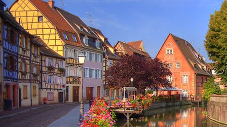 Half-timbered buildings line the river in Colmar © Dreamstime