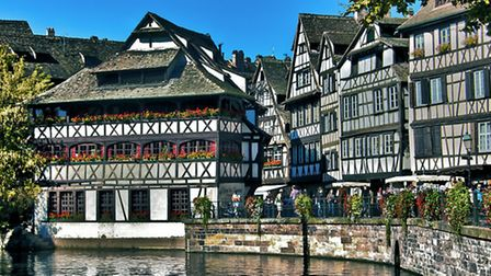 Black and white timber-framed buildings line the historic centre of Strasbourg © Fotolia