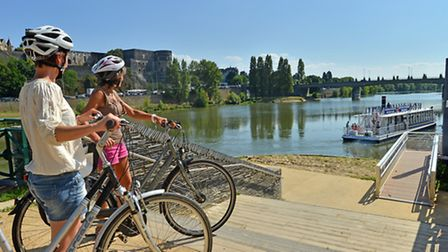 Cyclists pausing to admire the view across the Loire © Joel Damasse