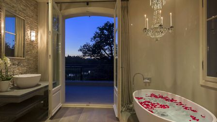 A large bath decorated in rose petals awaits inside one of the villa's six bathrooms