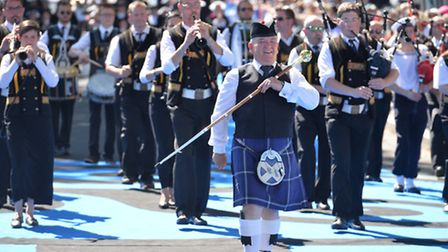 Groups of people dressed in Celtic attire at the Festival Interceltique in Lorient Michel Renac