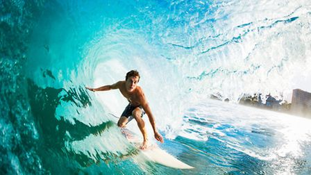 A surfer rides the waves at Lacanau Pro
