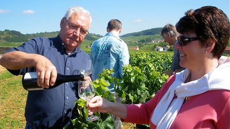 A guest is poured a glass of wine in the Domaine Coche-Bizouard