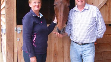 Alison and Roland with Walter the horse and their dog Henry