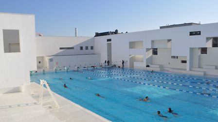 Bathers in outside pool at Bains des Docks complex