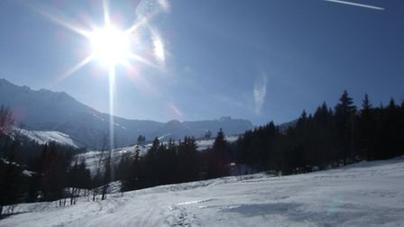 Sun on the snow in a nearby resort