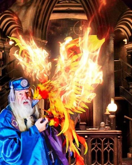 An actor portraying a magical headmaster with a pheonix
