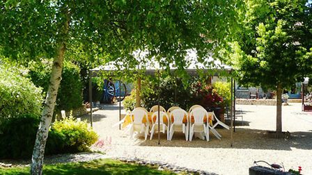 Each Monday, guests are invited to a communal dinner in the beautiful gardens of Les Coindries