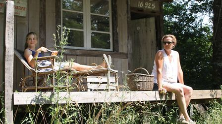 Grace and Sara relax on a sunny terrace © The French Retreat