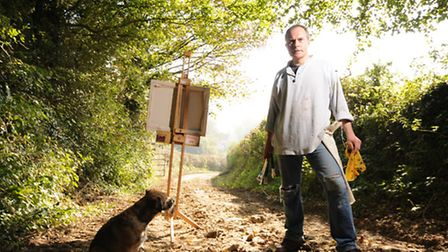 Nicholas Elliott works on a piece of in art in the beautiful Brittany countryside