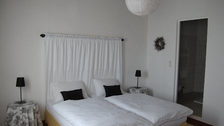 One of four bedrooms at Le Moulin