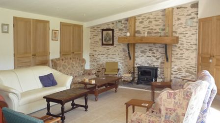 The house is full of character with exposed beams, stone walls and fireplaces
