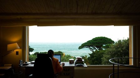A view to inspire: Hannah looks out on the sea from her peaceful study