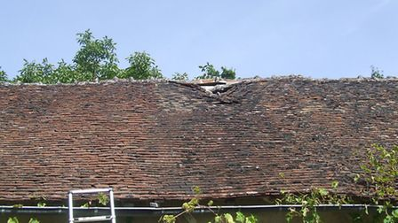 Poor maintenance has resulted in damage to this barn roof