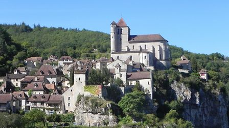 The medieval village of St-Cirq-Lapopie clings to a rocky outcrop