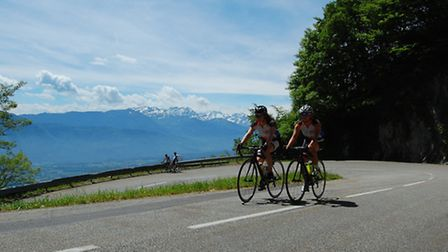 Two cyclists make their way up