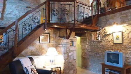 This lovely staircase is a striking feature of the property