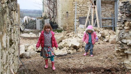 The couple's daughters Bella and Asha enjoyed helping with the renovations