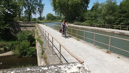 The towpath varies from wider sections to narrow tyre-width tracks