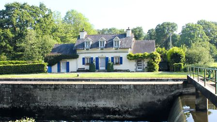 This charming lock-keeper's cottage sits by the Nantes à Brest canal in Brittany