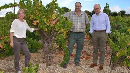 Laurent Delaunay (right) with vigneronne Hilde Chevillot and one of the estate's contracted growers