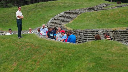 Visitors explore the Canadian trenches at Vimy Ridge