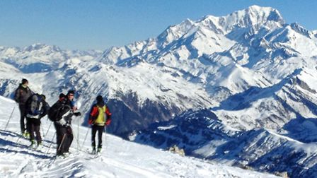 Skiers at the summit of Grand Mont in Areches-Beaufort