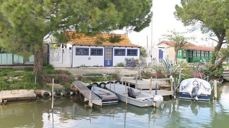 Canalside houses in the Petit Camargue