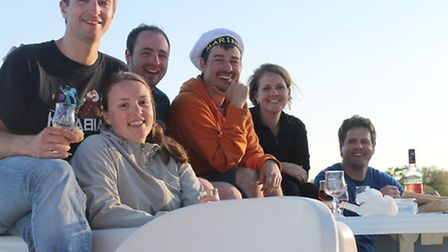 Alison and her husband Tim (right) enjoy an aperitif on board with their friends