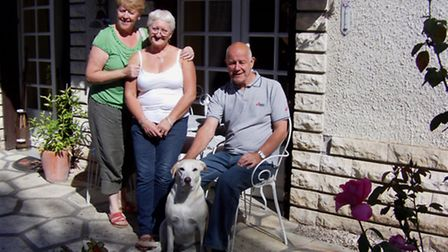 Angela and her husband with one of their guests and dog Cami
