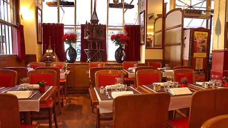 The dining room inside the Restaurant aux Charpentiers