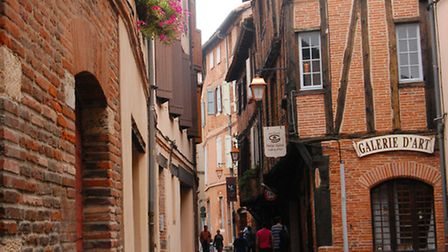 The winding medieval streets are lined with red-brick façades