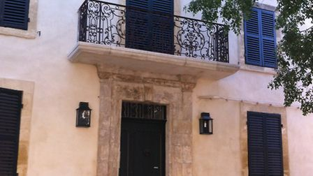 The original shutters, ironwork and doors have been restored to their former glory