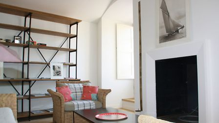 One apartment has a large open living space and a feature fireplace