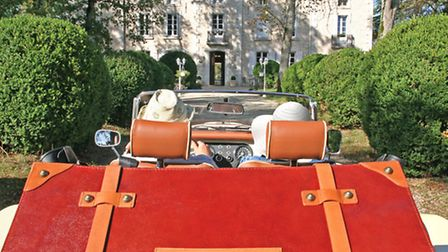 Arriving at a chateau in a Morgan car
