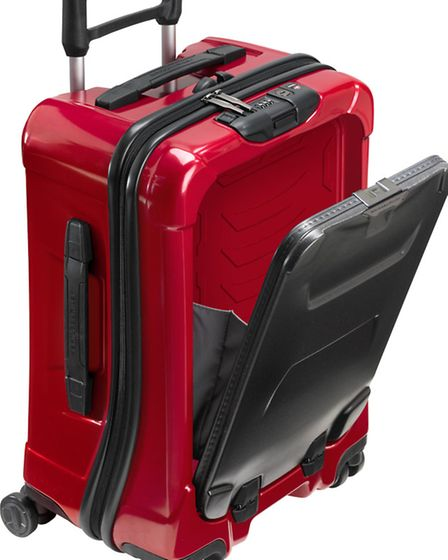 A ruby Torq carry-on suitcase from luxury manufacturer Briggs & Riley