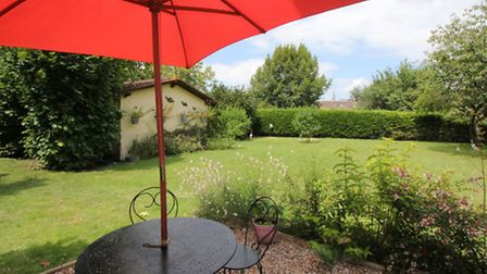The large lawned garden and gravelled patio