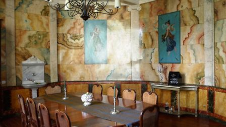 The grand dining room with trompe l'oeil marble panels