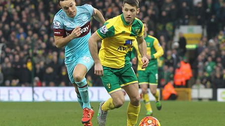 Mark Noble of West Ham and Wes Hoolahan of Norwich in action during the Barclays Premier League matc